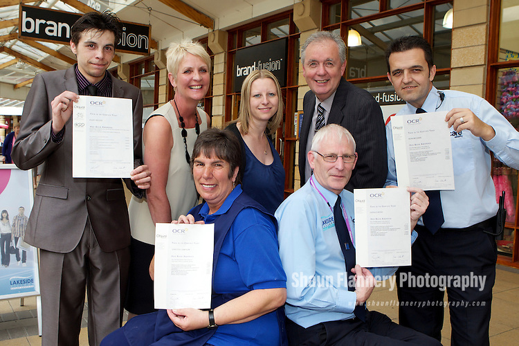 Pix: Shaun Flannery/shaunflanneryphotography.com...COPYRIGHT PICTURE>>SHAUN FLANNERY>01302-570814>>07778315553>>..6th May 2011.............Lakeside Village, Doncaster..Staff NVQ presentation..L-R (Back) Ricky Brodie, Moss, Cheryl Sadler, Manager Lakeside Village, Laura Clarkson, Deputy Manager Lakeside Village, George Elliott, Source Training Academy,  Sean McGann, Care Sec (Front) Dorothy Simpson, Insitu, Gerry Wood, Care Sec.
