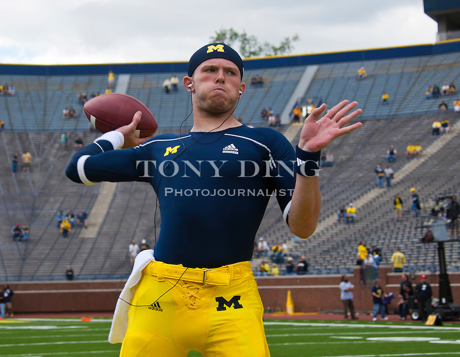 Michigan quarterback Tate Forcier throws practice passes during warmups before an NCAA college football game with Connecticut, Saturday, Sept. 4, 2010, in Ann Arbor, Mich. (AP Photo/Tony Ding)