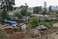 ETHIOPIA , Addis Abeba, construction boom, most of the construction is done by chinese companies, slums will be demolished and people are displaced to outskirts for new construction sites in the city centre  / AETHIOPIEN, Addis Abeba, Bauboom, die meisten Hochhaeuser werden von chinesischen Firmen gebaut, Abriss von Slumsiedlungen und Verdraengung der Menschen in Randbezirke