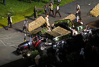 """27 JUL 2012 - LONDON, GBR - Performers dressed as 19th Century farmworkers load the rural scenery and props from the """"Green and Pleasant Land"""" section onto a tractor and trailer at the start of the """"Pandemonium"""" section of the Opening Ceremony of the London 2012 Olympic Games in the Olympic Stadium in the Olympic Park, Stratford, London, Great Britain (PHOTO (C) 2012 NIGEL FARROW)"""