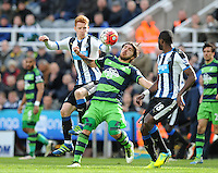 Jack Colback of Newcastle United (left) vies for the ball with Alberto Paloschi of Swansea City during the Barclays Premier League match between Newcastle United and Swansea City played at St. James' Park, Newcastle upon Tyne, on the 16th April 2016