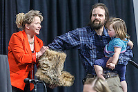 Cim Smyth and his daughter draw his starting position from a mukluk held by Anchorage Chrysler Dodge sponsor Kristine Horst at the 2016 Iditarod musher position drawing banquet at the Dena'ina convention center in Anchorage, Alaska on Thursday March 3, 2016  <br /> <br /> © Jeff Schultz/SchultzPhoto.com ALL RIGHTS RESERVED<br /> DO NOT REPRODUCE WITHOUT PERMISSION