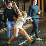 """© Joel Goodman - 07973 332324 . NO SYNDICATION PERMITTED . 20/12/2014 . Manchester , UK . A woman slips and falls on Bootle Street . """" Mad Friday """" revellers out in the rain and cold in Manchester . Mad Friday is typically the busiest day of the year for emergency services , taking place on the last Friday before Christmas when office Christmas parties and Christmas revellers enjoy a night out .  Photo credit : Joel Goodman"""