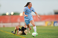 Danielle Johnson (15) of Sky Blue FC gets past a fallen Marta (10) of FC Gold Pride. FC Gold Pride defeated Sky Blue FC 1-0 during a Women's Professional Soccer (WPS) match at Yurcak Field in Piscataway, NJ, on May 1, 2010.
