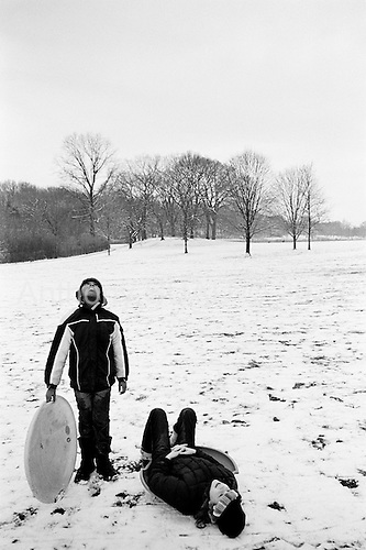 Brooklyn, New York<br /> USA<br /> December 20, 2009<br /> <br /> Oxanna Suau and her friend Thaliyah Fraser, both 9 years old, sled in Prospect Park.
