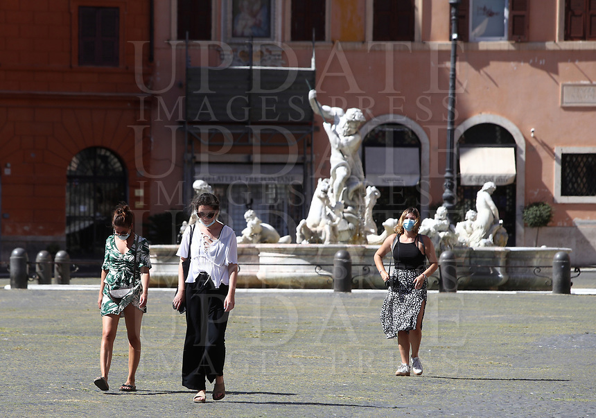 Girls walks in Piazza Navona in central Rome on May 4, 2020 as Italy starts to ease its lockdown, during the countrys lockdown aimed at curbing the spread of the COVID-19 infection, caused by the novel coronavirus.<br /> UPDATE IMAGES PRESS/Isabella Bonotto