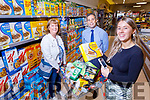 Trying out the Garveys Castleisland Superscan scanning device in Castleisland on Thursday.  Front right: Laura Foran. Back l to r: Helena Foran and Seamus O'Connor (General Manager).