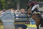 WIESBADEN, GERMANY - MAY 28: Jumping competition at the 76th international horse show held at the Schlosspark Biebrich at whitsun on May 28, 2012 in Wiesbaden, Germany. (Photo by Dirk Markgraf)