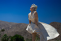 """""""Forever Marilyn,"""" Johnson's 26-feet-tall sculpture, with the dry hills and blue sky of Palm Springs, California USA"""