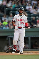 Second baseman Yoan Moncada of the Greenville Drive reacts to a strike in a game against the Rome Braves on Monday, June 15, 2015, at Fluor Field at the West End in Greenville, South Carolina. The Cuban-born 19-year-old Red Sox signee has been ranked the No. 1 international prospect in baseball by Baseball America. (Tom Priddy/Four Seam Images)