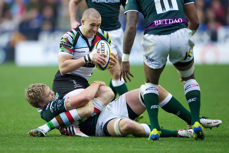 Mike Brown of Harlequins is tackled by Jamie Gibson of London Irish during the Aviva Premiership match between London Irish and Harlequins at the Madejski Stadium on Sunday 28th October 2012 (Photo by Rob Munro)