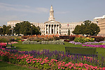 Flowers and bench in Civic Center Park with Denver City and County Courthouse, Denver, Colorado. .  John offers private photo tours in Denver, Boulder and throughout Colorado. Year-round Colorado photo tours.