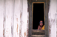 A Buddhist Monk with his sun glasses at a Monastery in Luang Prabang, Laos