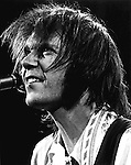 Neil Young performs onstage at the Palladium Theater in New York City in November, 1976.