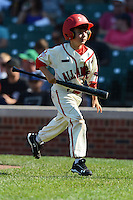National team bat boy takes a bat off the field during the Under Armour All-American Game on August 24, 2013 at Wrigley Field in Chicago, Illinois.  (Mike Janes/Four Seam Images)