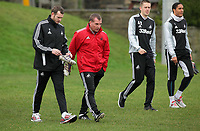 FAO SPORTS PICTURE DESK<br /> Pictured: Manager Brendan Rodgers (2nd L) with players L-R Craig Beattie, Gylfi Sigurdsson and Ashley Williams. Thursday 12 January 2012<br /> Re: Premier League football side Swansea City FC training session at Llandarcy, south Wales.