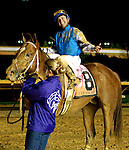 Jockey Joe Bravo celebrates his win aboard Dule of Mischief in the $1,000,000 Grade 3 Charles Town Classic at Charles Town Races and Slots in Charles Town, West Virginia on April 17, 2011