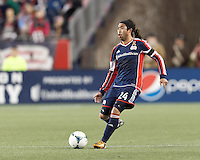 New England Revolution midfielder Lee Nguyen (24) passes the ball. In a Major League Soccer (MLS) match, the New England Revolution (blue/red) defeated Philadelphia Union (blue/white), 2-0, at Gillette Stadium on April 27, 2013.
