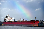 Pictured: A rainbow over the Nave Andromeda at berth in Port of Southampton this morning, following the major incident off the east coast of the Isle of Wight after 7 stowaways were detained from the vessel after a reported hijacking. <br /> <br /> SEE OUR COPY FOR DETAILS.<br /> <br /> © Simon Czapp/Solent News & Photo Agency<br /> UK +44 (0) 2380 458800