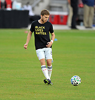 WASHINGTON, DC - SEPTEMBER 27: Scott Caldwell #6 of New England Revolution warming up during a game between New England Revolution and D.C. United at Audi Field on September 27, 2020 in Washington, DC.