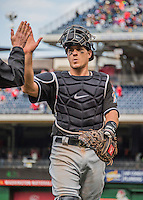 15 May 2016: Miami Marlins catcher J.T. Realmuto gets congratulated with a high five after a game against the Washington Nationals at Nationals Park in Washington, DC. The Marlins defeated the Nationals 5-1 in the final game of their 4-game series.  Mandatory Credit: Ed Wolfstein Photo *** RAW (NEF) Image File Available ***