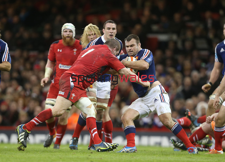Wales prop Gethin Jenkins tackles French front rower Nicolas Mas.<br /> RBS 6 Nations 2014<br /> Wales v France<br /> Millennium Stadium<br /> 21.02.14<br /> <br /> ©Steve Pope-SPORTINGWALES