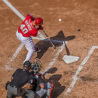 28 September 2014: Washington Nationals catcher Wilson Ramos connects against the Miami Marlins at Nationals Park in Washington, DC. The Nationals shut out the Marlins 1-0, caping the season with the first Nationals no-hitter in modern times. The win also notched a 96 win season for the Nats: the best record in the National League. Mandatory Credit: Ed Wolfstein Photo *** RAW (NEF) Image File Available ***