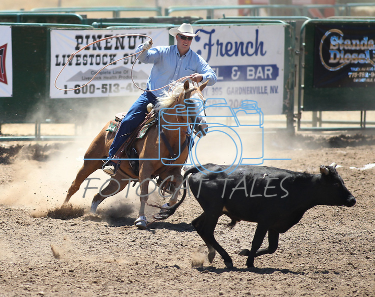 Dan Coverly competes in the team roping event at the Minden Ranch Rodeo on Saturday, July 23, 2011, in Gardnerville, Nev..Photo by Cathleen Allison