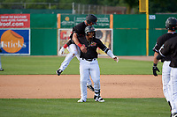 Batavia Muckdogs Nic Ready (51) jumps on Albert Guaimaro (13) after a walk off single during a NY-Penn League game against the Auburn Doubledays on June 19, 2019 at Dwyer Stadium in Batavia, New York.  Batavia defeated Auburn 5-4 in eleven innings in the completion of a game originally started on June 15th that was postponed due to inclement weather.  (Mike Janes/Four Seam Images)