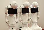 July 20, 2016, Tokyo, Japan - Softbank's humanoid robot Peppers sleep before starting a press preview of the Pepper World exhibition in Tokyo on Wednesday, July 20, 2016. Pepper's latest applications and accessories will be exhibited at the Pepper World robot exhibition on July 21 and 22.      (Photo by Yoshio Tsunoda/AFLO)
