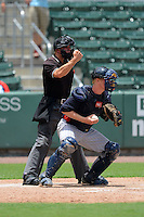 Umpire Justin Houser makes a call behind catcher Alex Swim during a game between the GCL Red Sox and GCL Twins on July 19, 2013 at JetBlue Park at Fenway South in Fort Myers, Florida.  GCL Red Sox defeated the GCL Twins 4-2.  (Mike Janes/Four Seam Images)