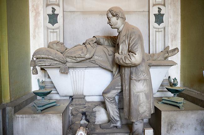Pictures of a son and his dying father, In memory of a Portuguese patrician Battista Noli Da Costa. Sculpted in a realistic style by Risorgimento sculptor S Saccomanno in 1887, Section A, no 3, Staglieno Monumental Cemetery, Genoa, Italy