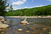 Rock stacking along the East Branch of the Pemigewasset River from the Riverwalk Trail in Lincoln, New Hampshire during the spring months.