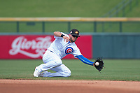 Mesa Solar Sox second baseman David Bote (15), of the Chicago Cubs organization, makes a sliding play during a game against the Salt River Rafters on October 18, 2017 at Sloan Park in Mesa, Arizona. The Rafters defeated the Solar Sox 6-5.(Zachary Lucy/Four Seam Images)
