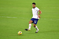 ORLANDO CITY, FL - JANUARY 31: Miles Robinson #12 of the United States passes off the ball during a game between Trinidad and Tobago and USMNT at Exploria stadium on January 31, 2021 in Orlando City, Florida.