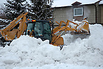 Snow removal with back hoe machine