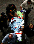 A patient is transported after being evacuated by helicopter to a makeshift transport hub on Interstate 10 and North Causeway Blvd. in Metairie near the edge of New Orleans on Thursday, September 1, 2005.  Hurricane Katrina caused many parts of the city to flood.  (Fort Worth Star-Telegram/Khampha Bouaphanh)