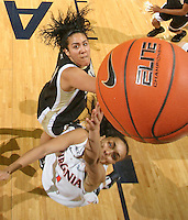 Feb. 3, 2011; Charlottesville, VA, USA; Virginia Cavaliers guard China Crosby (1) is defended by Wake Forest Demon Deacons forward Sandra Garcia (21) as she makes a basket during the game at the John Paul Jones Arena. Virginia won 73-46. Mandatory Credit: Andrew Shurtleff