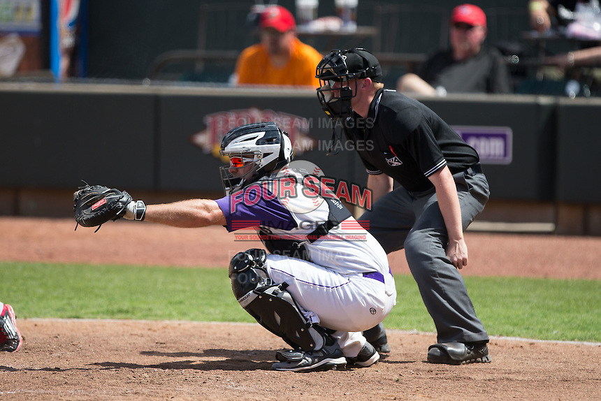 Winston-Salem Dash catcher Jeremy Dowdy (21) frames a pitch as home plate umpire Chase Eade looks on during the game against the Salem Red Sox at BB&T Ballpark on May 31, 2015 in Winston-Salem, North Carolina.  The Red Sox defeated the Dash 6-5.  (Brian Westerholt/Four Seam Images)