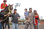 Jockey Willie Martinez and Trinniberg's connections head into the winners circle after winning the Swale Stakes(G3) at Gulfstream Park, Hallandale Beach Florida. 03-10-2012
