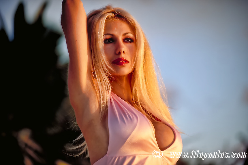 Beautiful young blond woman portrait outdoors
