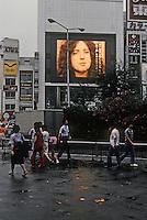Tokyo: Giant TV screen, Shinjuku Station. (American Rock Musician in interview) Photo '81.