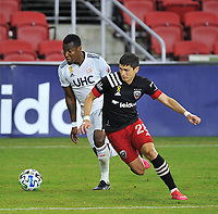 WASHINGTON, DC - SEPTEMBER 27: Joseph Mora #28 of D.C. United battles for the ball with Cristian Penilla #70 of New England Revolution during a game between New England Revolution and D.C. United at Audi Field on September 27, 2020 in Washington, DC.