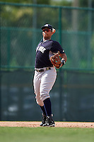 GCL Yankees 2 third baseman Dermis Garcia (93) throws to first during the first game of a doubleheader against the GCL Pirates on July 31, 2015 at the Pirate City in Bradenton, Florida.  GCL Pirates defeated the GCL Yankees 2 2-1.  (Mike Janes/Four Seam Images)