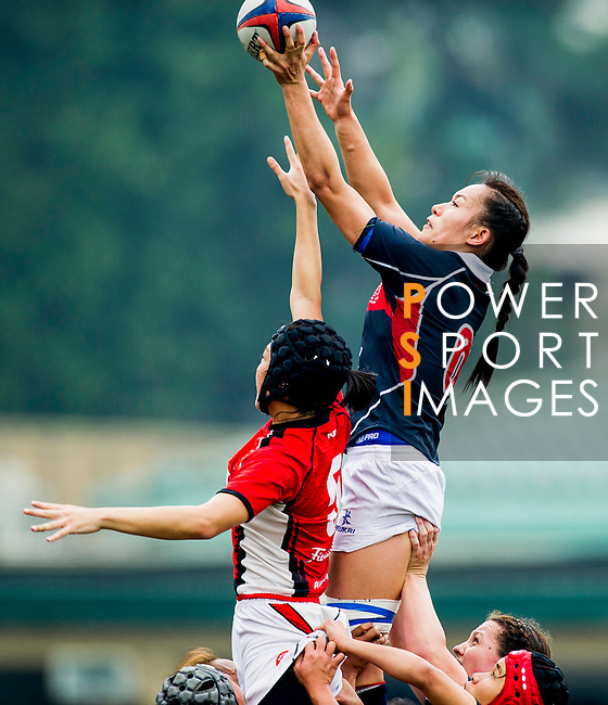Hong Kong play Singapore during their HSBC Asian Five Nations 2013 Top 5 Division Women match at the Hong Kong Football Club on 27 April 2013 in Hong Kong. Photo by Victor Fraile / The Power of Sport Images