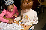 Elementary School New York Grade 3 math game two students working together horizontal boy and girl