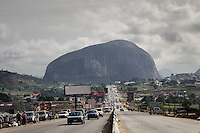 Zuma Rock is a large monolith (725 meters or 2,379 ft) above its surroundings along the main road from Abuja to Kaduna, Nigeria.