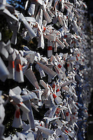 New Year prophecies  hang at a shrine in a residential area in Tokyo, Japan.  The Japanese celebrate the first three days of the New Year which are public holidays and days of rest of visits to shrines and temples.
