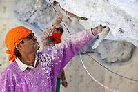 India, Dehradun.  Tapkeshwar Hindu Temple.  An Indian Painter Showing Signs of Being Hard at Work.
