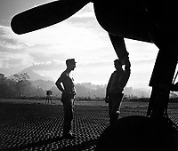 VF-17 ground crewmen await word to ready F4U for takeoff on Rabaul raid from Piva strip on Bougainville.  February 1944.  Lt. Comdr. Charles Fenno Jacobs.  (Navy)<br /> Exact Date Shot Unknown<br /> NARA FILE #:  080-G-475071<br /> WAR & CONFLICT BOOK #:  967
